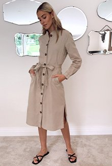 Model Meg wearing a beige long sleeve dress with tie waist