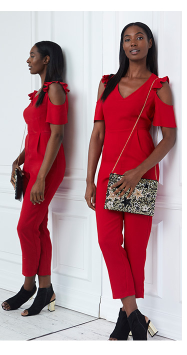 Model in red outfit with handbag