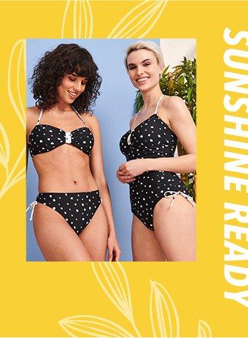 Two Women wearing black and white polka dot bikini and swimsuit