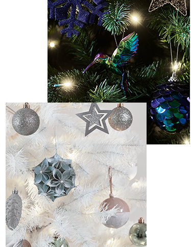 Christmas tree branches decorated with purple and gold decorations and white decorations