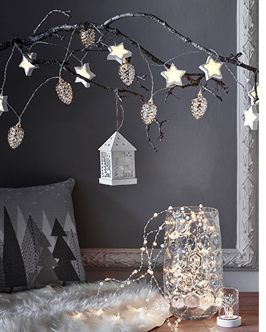 White Christmas star lights draped over a branch