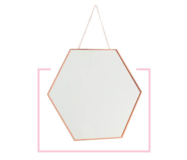 Add the finishing touch to the room with a hexagonal mirror