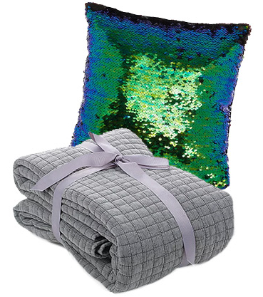 Accessorise with a grey throw and sequin cushion