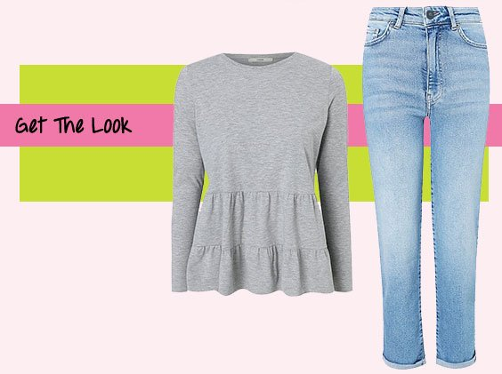 Grey long sleeved tiered peplum top and blue light wash straight leg jeans.