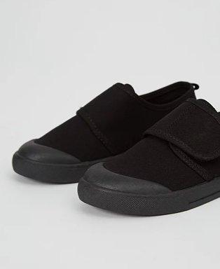 Black non-marking sole plimsoll school pumps.