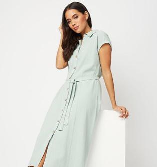 Woman wearing a turquoise tie waist shirt dress
