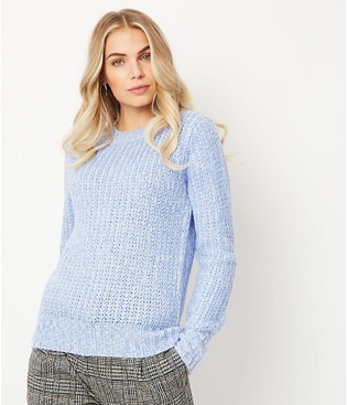 Woman wearing a blue knitted jumper