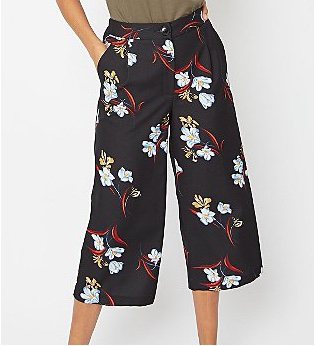 Woman wearing black floral straight leg culottes