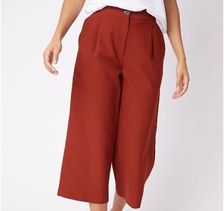 Woman wearing rust straight leg culottes