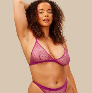 Woman posing in pink triangle bra and brief set.