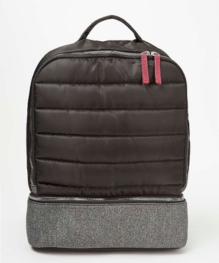 Black quilted grey panel backpack.