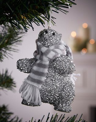 Silver glitter polar bear bauble with grey and white scarf.