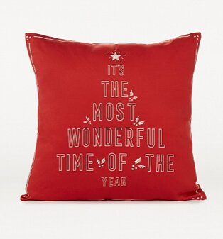 Red Christmas slogan print cushion.