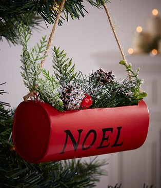 Red Noel hanging basket bauble placed on Chrismas tree.