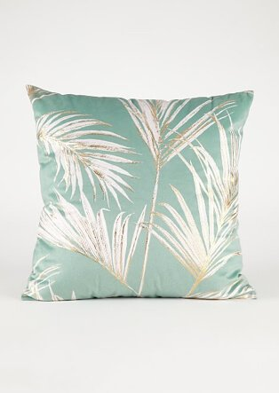Green cushion with leaf pattern
