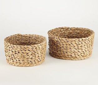 Two circular wicker baskets