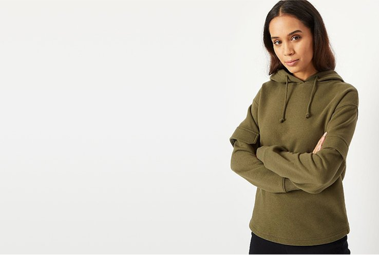 Woman wearing a khaki hoody
