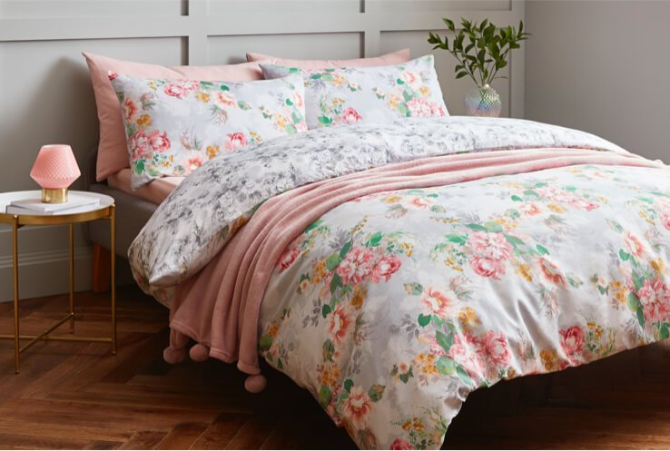 Double bed with floral patterned bedding