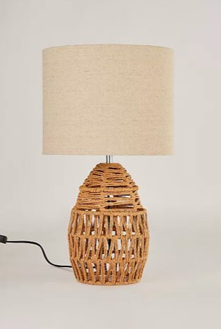 Rattan table lamp with cream shade.
