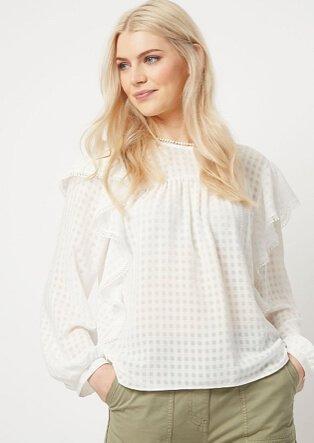 Woman wearing white blouse and khaki trousers