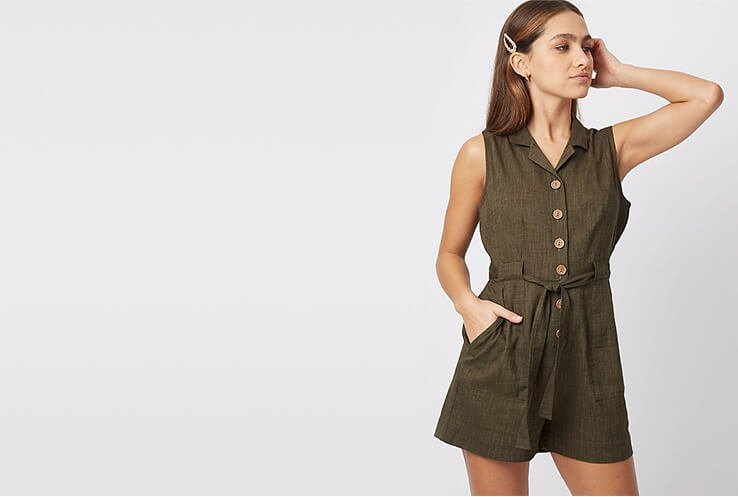 Woman wearing a khaki playsuit with tie waist