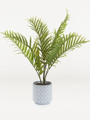 Artificial palm plant in grey decorative pot.