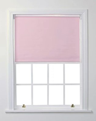 White window with pink blackout roller blind.