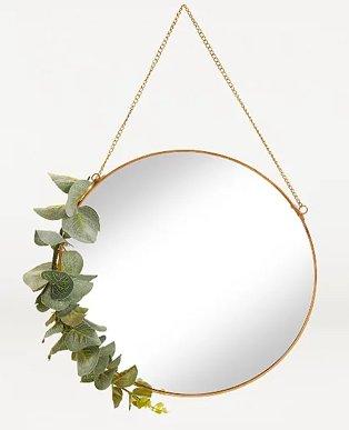 Gold-effect eucalyptus mirror.