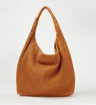 A tan handbag.