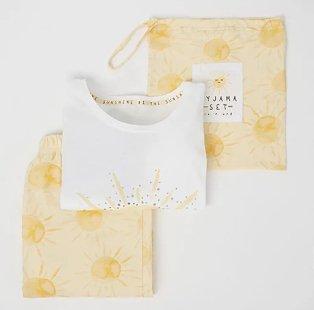 White and yellow sunshine print pyjamas with bag.