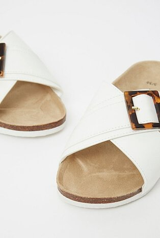 White crossover sandals with a moulded footbed and resin buckle detail