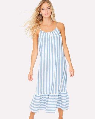 Woman poses wearing blue stripe ruffle hem midi cover up dress.