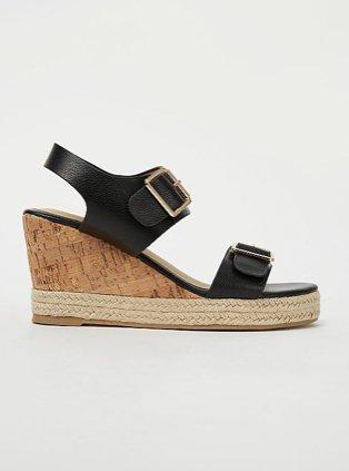 Black wedge heeled sandals.