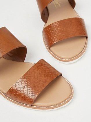 Tan double strap mule sandals.