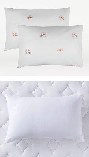 White rainbow patterned pillowcase pair. White pillow on white diamond mattress topper.