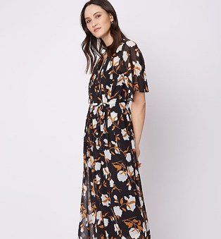 Woman in black floral pleated 2 in 1 v-neck midi dress