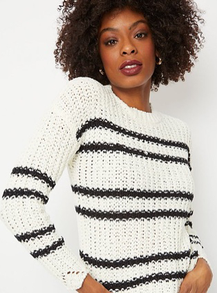 Woman in white stripe scallop hem jumper