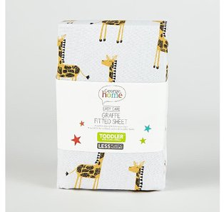 A white giraffe fitted sheet for a toddler bed