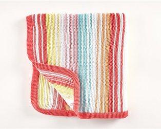 A folded rainbow knitted shawl