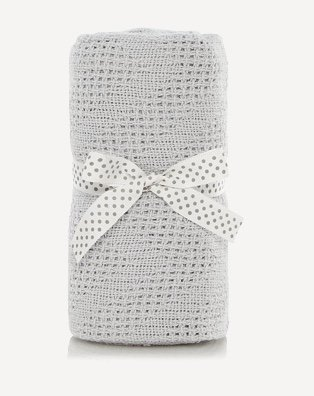 Grey striped baby shawl tied folded and tied with a polka dot ribbon
