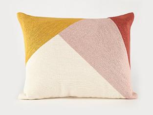 Geometric cushion in pink, cream, mustard and burnt orange