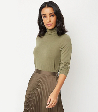 Woman wearing a khaki top and matching skirt