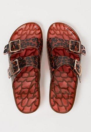 Brown buckled tortoiseshell print sandals