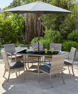 Jakarta 8 piece patio set in an outdoor area with drinks and plates on the table