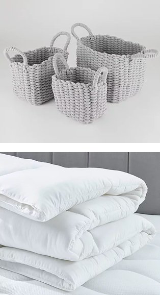 Small, medium and large grey wicker baskets with handles. White duvet rolled up on white mattress topper.