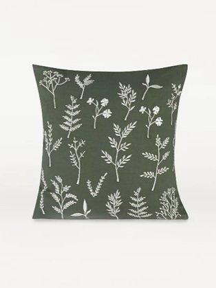 Green forage living room cushion.