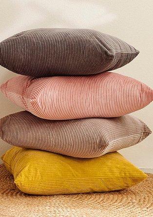 Stack of charcoal, pink, natural and honey jumbo cord cushions.