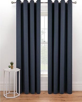 Large windows with charcoal full length curtains.