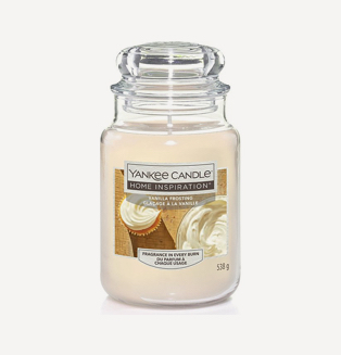 A vanilla frosting scented Yankee candle in a glass jar