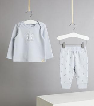Billie Faiers unisex blue bunny rabbit slogan pyjamas hanging from ribbon on white hangers